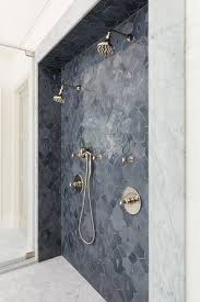 walk in shower with gray fleur de lis mosaic tiles transitional