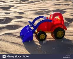 Brightly Coloured Plastic Toy Truck On Sandy Beach Stock Photo ... New Arrival Pull Back Truck Model Car Excavator Alloy Metal Plastic Toy Truck Icon Outline Style Royalty Free Vector Pair Vintage Toys Cars 2 Old Vehicles Gay Tow Toy Icon Outline Style Stock Art More Images Colorful Plastic Trucks In The Grass To Symbolize Cstruction With Isolated On White Background Photo A Tonka Tin And Rv Camper 3 Rare Vintage 19670s Plastic Toy Trucks Zee Honk Kong Etc Fire Stock Image Image Of Cars Siren 1828111 American Fire Rideon Pedal Push Baby Day Moments Gigantic Dump