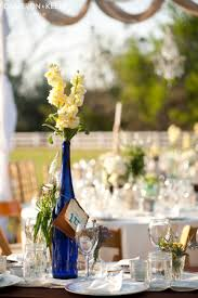 Tall bottles with flowers can help with adding depth and dimension