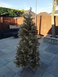 Slimline Christmas Tree by 1 8m 6ft Gold Slimline Christmas Tree With Lights And Loads Of