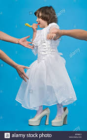 funny girl in white dress in big shoes walking father