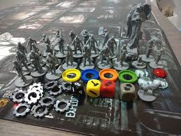 A Collection Of 28 Mm Plastic Miniatures Dice And Assorted Tokens