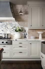 Light grey kitchen cabinets subway tile backsplash