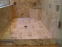 this travertine shower uses granite slabs and tiles as accents as