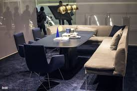 Blue Dining Chair Light Brown Bench Gold Accent Pendnat Lights Navy Rug Cushion Seating Coupled With Dashing Table In The Contemporary Room