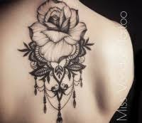 Vintage Style Black Ink Upper Back Tattoo Of Large Rose With Leaves By Caro Voodoo