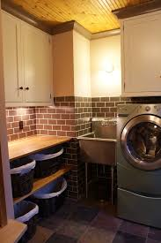 stainless steel utility sink laundry room eclectic with none