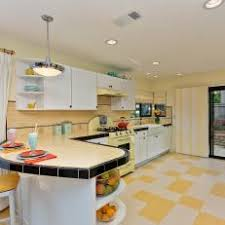 Retro Kitchen With Buttery Yellow Countertop And Checkered Floors