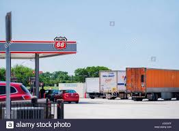 Semi Trucks Parked At A Rest Stop While Customers Fuel Up At A ... Truck Stop America Stock Photos Images Road Tripping Across The Heartland With Kiddo Get Involved Travel Pictures Truck Trailer Transport Express Freight Logistic Diesel Mack Driver Wounds Man Kills Himself At Truck Stop Youtube Fuel Island Petro Raphine Virginia Classic Truckstop Gas Stations And Stops Of Days Gone By Aprs Boulot Our Life After Work May 2016 Worlds Largest Inrstate 80 Iowa Pinterest An Ode To Trucks An Rv Howto For Staying At Them Girl Big Rig Trucks In Parked Mojave California