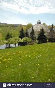 Dandelions Grow In The Foreground As New Spring Grass Grows At The ... Mad River Valley Getaway Prize Profile The Round Barn Farm Inn At Waitsfield Vt 17900 Special Quote For Weddings Vermont New York Wedding Photographer Christian Bookingcom Historian Speaks About Round Barn Demise Shelburne Museum Barns Preserving A Truly American Tradition Prints And Pating Artisans Gallery 67 Best Venue Ish Images On Pinterest Venues Real England Allie Lemke John Sharry Waitsfields Owner Seeks Successor Business