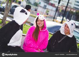 Close Up Of A Happy Group Friends Having Fun Conversation And Wearing Different Costumes One Woman Pink Unicorn Costume Other Panda