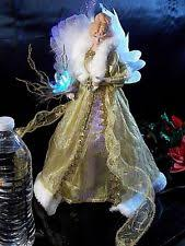 Vickerman Christmas Tree Topper by Vickerman Lighted Cream And Gold Fiber Optic Angel Christmas Tree