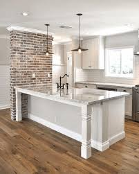 exposed brick wall industrial black hanging light white kitchen