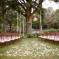 A Simple Ceremony Under Tree Love The Heart Shaped Wreath Detail Photo Outdoor Wedding CeremoniesSimple DecorationsSimple
