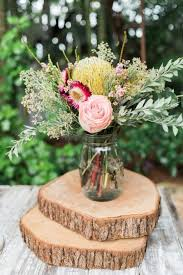 Boho Chic Rustic Affordable Wedding Centerpieces By Simply Using Roses Green Filler Flowers Olive Branches And A Mason Jar