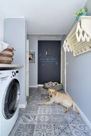 clothes rack laundry room traditional with patterned floor tile