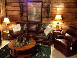 Living Room Small Rustic Ideas With Brown Textured Wood Wall And Round Coffee Table Plus Dark Laminated Leather Sofa