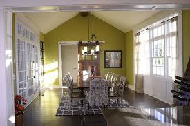 Modern Dining Room In Green With Sliding Barn Door