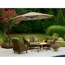 Exterior Beige Tar Patio Umbrellas With Wicker Patio Furniture