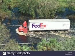 Federal Express Truck FedEx Driving Through Flooded Road After Stock ... Overturned Fedex Truck Shuts Down Part Of I95n In Westwood Necn Tnt Express Track Parks Dtown Melbourne Australia Express Pickup And Delivery Service Options Freight Ltl Shipping Forms Canada Hazardous Materials Forecasts Record Volume This Holiday Season Volvo Trucks Successfully Demonstrate Platooning On Advanced Shipment Tracking Web Shoppers Beware To Charge By Package Size Wsj Caught Video Uta Frontrunner Train Crashes Into Truck