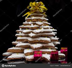 Homemade Gingerbread Christmas Tree With Small Red Gifts On Dark Stock Photo