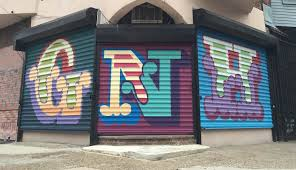Philadelphia Mural Arts Program Jobs by London Street Artist Painting Entire Alphabet On Philly Roll Down