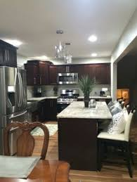 Kitchens With Dark Cabinets And Light Countertops by 20 Beautiful Kitchens With Dark Kitchen Cabinets Home U0026 Living