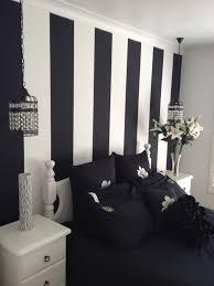 Inspiring Painted Wall Designs For Bed Room By Black White Stripped Feat Bedsheet Between