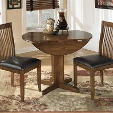small round drop leaf dining table with wooden base painted with