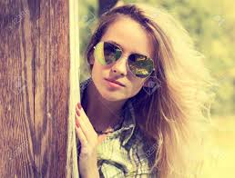 Pretty Fashion Hipster Girl In Glasses Peeking Summer Modern Youth Lifestyle Toned Vintage Style