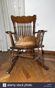 A Norwegian Cat Sleeping On A Rocking Chair Stock Photo ...