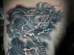 Black Ink Chinese Dragon Tattoo On Left Side Rib