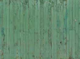 Weathered Turquoise Planks With Spots And Fading Paint Arranged Vertically