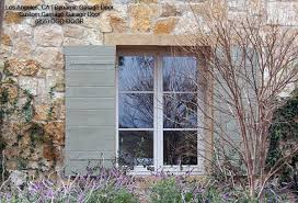Decorative Rustic Shutters In A Tuscan Style Design Mediterranean Exterior