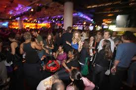 a crowd assembled in the v i p area at the conga room for