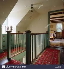 Sage-green Painted Banisters On Country Landing With Woven Red ... The 25 Best Painted Banister Ideas On Pinterest Banister Installing A Baby Gate Without Drilling Into Insourcelife Stair Banisters Small Railing Stairs And Kitchen Design How To Stain Howtos Diy Amusing Stair Banisters Airbanisterspindles Of Your House Its Good Idea For Life Exceptional Metal Wood Stainless Steel Bp Banister Timeless And Tasured My Three Girls To Staircase Staircase Including Wooden Interior Modern Lawrahetcom Tiffanyd Go Black