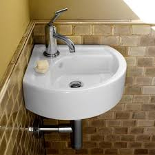 Small Wall Mounted Corner Bathroom Sink by Simple And Elegant Corner Bathroom Sink