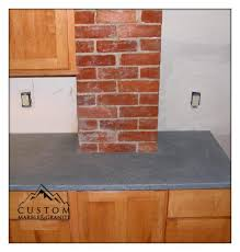 American Soapstone Counter Tops With Exposed Brick Chimney