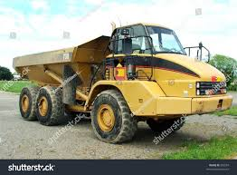 Large Dump Truck Stock Photo (Royalty Free) 692559 - Shutterstock Rc Large Dump Truck 27mmhz By Kid Galaxy Kgr20238 Toys Hobbies Gta 5 Location And Gameplay Youtube Mini Bed Kit Also Volvo Or Images As Well End Rental And Dump Truck Stock Image Image Of Dozer Cstruction 6694189 Caterpillar Cat 794 Ac Ming In Articulated On Cstruction Job Stock Photo Download Now A Large Driving Through A Mountain Top Coal Ming Heavy Duty Rear View Picture Chevy One Ton For Sale Together With Capacity New Quarry Loading The Rock Dumper Yellow Euclid Used To Haul Material Mega Bloks Only 1799 Frugal Finds