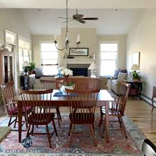 Sherwin Williams Canvas Tan In Open Layout Living And Dining With Vaulted Ceilings Fireplace