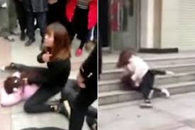 Love Rat Lets Girlfriend And Secret Mistress Brawl In Street Before Kicking Onlooker For Trying To Break It Up