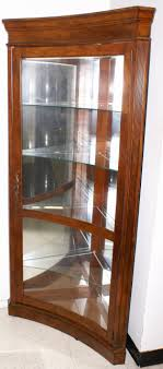 concave glass front mahogany corner curio cabinet display