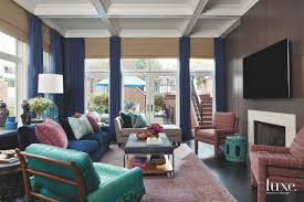 jewel tone living room with fireplace curtains and floor to