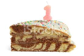 Premium Stock of Slice of Birthday Cake With Number e Candle
