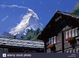 100 Zermatt Peak Chalet The Peak Of The Matterhorn Mountain Towering Above Chalet Rooftops