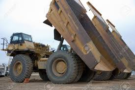 100 Large Dump Trucks Yellow Dump Trucks Lined Up With Beds Elevated