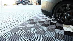 garage flooring inc installs vented xl modular flooring tiles