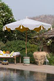 100 Wooden Parasols Step Into The Shade With A Colourful Garden Parasol Livingetc