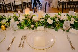 Floral Garland Is The Focus On This Gold Toned Head Table