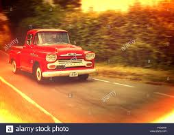 100 1960s Chevy Truck Chevrolet Pick Up Truck Driving Along Country Road Stock